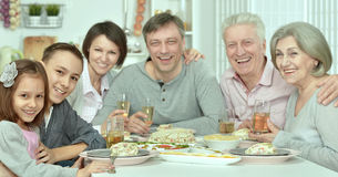 Family at the table with tasty food Stock Image