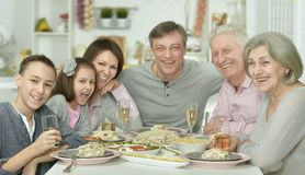 Family at the table with tasty food Royalty Free Stock Photo