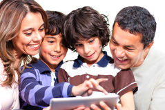 Family with a tablet computer Stock Images