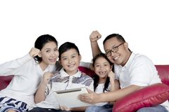 Family with tablet computer on sofa Stock Photo