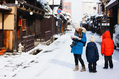 Family in Takayama town. Family of mother and kids at old district of historical Takayama town in Japan on winter day Royalty Free Stock Photos