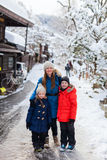 Family in Takayama town. Family of mother and kids at old district of historical Takayama town in Japan on winter day Stock Photography