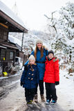 Family in Takayama town. Family of mother and kids at old district of historical Takayama town in Japan on winter day Royalty Free Stock Photography