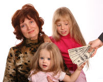 Family take money. Grandmother with granddaughters, takes money Royalty Free Stock Image