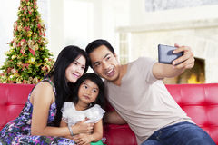 Family take a self photo together Stock Photography