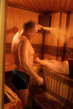 Family take a steam bath. In a sauna Royalty Free Stock Image