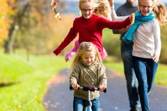 Family take walk in autumn forest flying kite Royalty Free Stock Photos