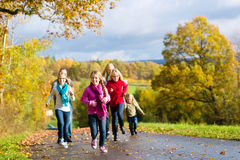 Family take a walk in autumn forest Stock Photos