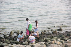 Family Take a walk on the beach in shenzhen bay Stock Photos