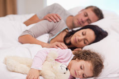 Family taking a nap together Stock Images