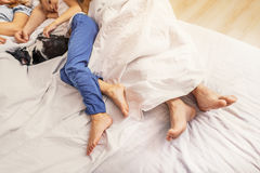 Family taking nap together on bed royalty free stock photos