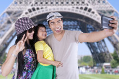 Family taking photo with camera phone in Paris Stock Image