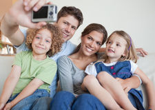 Family taking a photo of themselves Royalty Free Stock Photo