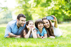 Family taking photo of themselves. Portrait of a happy family outdoors Royalty Free Stock Photography