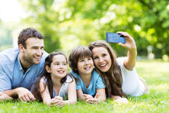 Family taking photo of themselves. Portrait of a happy family outdoors royalty free stock photo