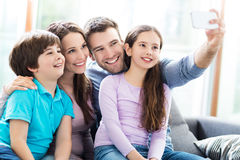 Family taking photo of themselves Royalty Free Stock Images