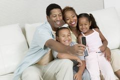Family Taking Picture of family on sofa with Camera Phone Royalty Free Stock Photo