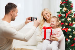 Family taking picture with smartphone at christmas Stock Photography