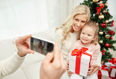 Family taking picture with smartphone at christmas Stock Photo