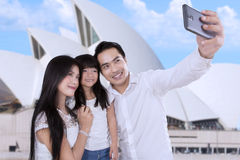 Family taking picture in sydney Stock Images