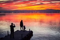 Free Family Taking Pictures In The Sunset Of The Calm Waters Of The Albufera De Valencia, Spain Royalty Free Stock Photos - 133163228