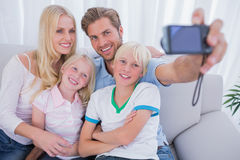 Family taking pictures. Of themselves in living room Stock Images