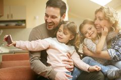 Happy family at home. stock image