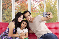 Family taking self portrait at home Royalty Free Stock Image