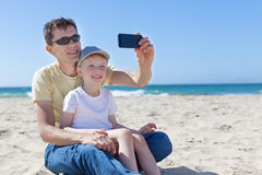 Family taking selfie at the beach Stock Photos