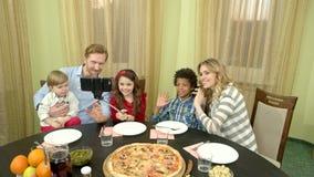 Family taking selfie, dining table. stock video