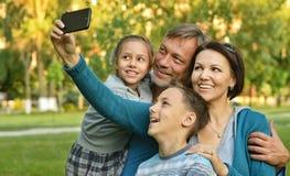 Family Taking Selfie In Park Stock Photos