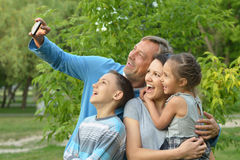 Family taking selfie in park Stock Photography