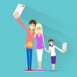 Family taking selfie photo on smart phone couple Royalty Free Stock Images