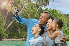 Family taking selfie on sea. Happy family taking selfie on the sea beach royalty free stock image