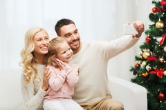Family taking selfie with smartphone at christmas Royalty Free Stock Photo