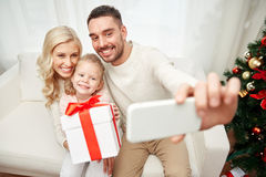 Family taking selfie with smartphone at christmas Royalty Free Stock Photography