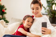 Family taking selfie by smartphone at home Stock Image