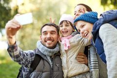 Family taking selfie with smartphone outdoors Stock Image
