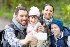 Family taking selfie with smartphone in woods Stock Image