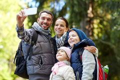 Family taking selfie with smartphone in woods Royalty Free Stock Images