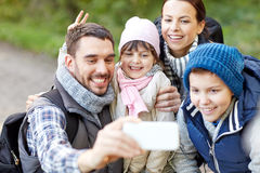 Family taking selfie with smartphone in woods Stock Photography