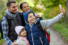 Family taking selfie with smartphone in woods Stock Photos