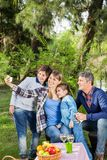 Family Taking Selfportrait At Campsite Royalty Free Stock Photos