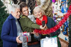 Family Taking Selfportrait At Christmas Store Stock Photo