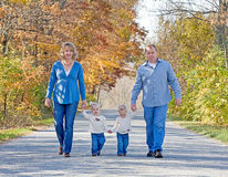 Family Taking a Walk. In the Autumn Royalty Free Stock Image