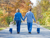 Family Taking a Walk. In the Autumn Royalty Free Stock Photos
