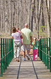 Family Taking a Walk. Family of Four Having Fun Taking a Walk Royalty Free Stock Images
