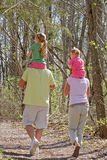 Family Taking a Walk. Family of Four Having Fun Taking a Walk Royalty Free Stock Photography