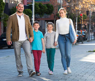 Family taking a walk in town Royalty Free Stock Images