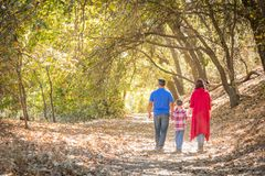 Family Taking a Walk At The Woods. Mixed Race Caucasian and Hispanic Family Taking a Walk At The Park royalty free stock photos